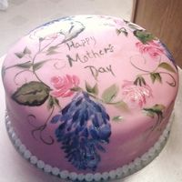 Pink champagne cake with a strawberry cheesecake mousse filling. Buttercream frostingcovered in fondant. First time to hand paint cake.. Turned out pretty good I think but would like to practice tecknique a liitle more.