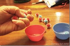 Using pom poms and cups for in hand manipulation -  Pinned by @PediaStaff – Please Visit ht.ly/63sNt for all our pediatric therapy pins