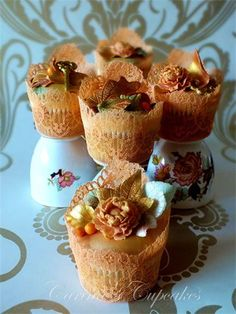 AUTUMNAL TREASURES  'Ornamental' Collection    An eclectic assortment of golds, bronzes and green flora and fauna and glittering gold treasures.Featuring the stunning 'Secret Garden key' cupcake, a 100% edible golden key nestled atop glimmering autumn leaves.