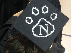 A graduate shows off her decorated cap prior to one of Northwest's spring commencement ceremonies, May A record 708 individuals received bachelor's and master's degrees from Northwest during spring commencement exercises.
