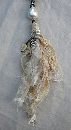 Beautiful tassels made with remnants of muslin,pearls and vintage lace ~by Nina Bagley .I see a beautiful spirit doll represented in this lovely tassel. Vintage Lace, Vintage Jewelry, Handmade Jewelry, Vintage Teacups, Antique Lace, Textile Jewelry, Fabric Jewelry, Jewellery, Fabric Art