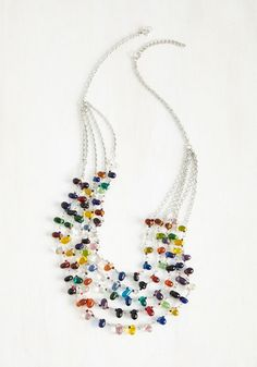 Accelerate the allure of any ensemble with this colorful statement necklace! Revved up with shining silver chains and an array of prismatic glass beads, this accessory aims to fuel your spirited style in no time flat.