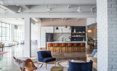 Modern Workplace Design: Tour Wit & Delight's Studio 125 in Minneapolis - Refine & Define by Cambria Studio Floor Plans, Open Space Office, Wit And Delight, Commercial Office Space, Studio Kitchen, The Originals Characters, Workplace Design, Panel Doors, Living Area