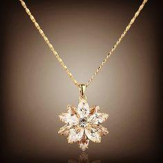 Make your heart blossom with this flower #jewelry #beautiful #zirconia #swarovski #precioustreasure #sunflower #blossom