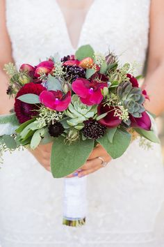 Dahlia, scabiosa and succulent wedding bouquet: Photography : Brooke Beasley Photography Read More on SMP: http://www.stylemepretty.com/california-weddings/sonoma/2017/01/30/a-berry-hued-wine-country-wedding-for-the-books/