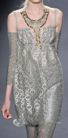 Anna Sui S/S 2013- reminiscent of the sheer chemise, dog collar and embroidery of fabric