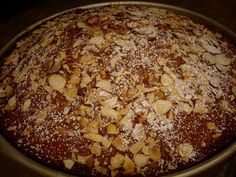 Vasilopita Cake recipe. (Greek New Years Cake for good luck) HALVE THIS RECIPE! I tried it full and it is too much, it just didn't work.  I halved it and it was great but the baking time needs to be extended!  It was very good though!