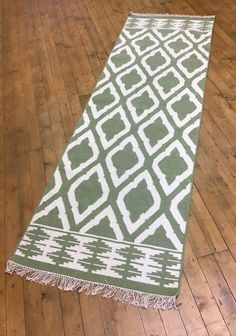 Green White Geometric Wool Cotton Kilim Rug 75 cm x 240 cm. A runner Kilim rug.  Material – 80% Wool and 20% Cotton. Design – Geometric. Colour – Green and White.