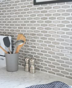 Budget Kitchen Makeover | Centsational Girl Featuring contemporary edge Formica® Laminate Carrara Bianco countertop, white cabinets, and gray tile backsplash. Closer look at the backsplash. #whitecountertop #kitchen #marble
