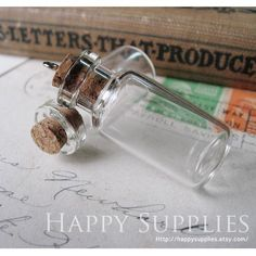 20 LARGE 50x22mm Clear Glass Fillable Tiny Bottle Vials Charms / Pendants with 20 EYEHOOKS (L). $9,10, via Etsy.