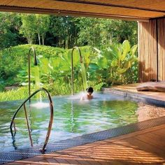View pictures of exquisite indoor pool designs. An indoor swimming pool offers the luxury of year-round enjoyment as well as privacy.