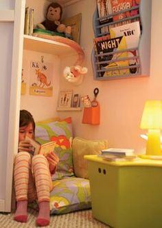 Reading nook.. Cute like the dresser & wall hanger for books. Charlie would love this!