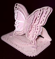 Layered easel card Butterfly on Craftsuprint designed by Carol Dunne - made by Dianne Jackson - I cut out using pink pearl and a darker shade of matt pink card and layered them alternately with the pearl on the top parts. I layered using sticky pads on the body parts only and shaped the wings outwards. I added the swirly stopper and then added the with love oval in the centre of the stopper.....what can I say about this