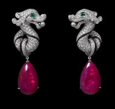 Chinese Influences – High Jewelry Ring White gold, two ruby drops totaling 21.47 carats, emerald eyes, two natural pearls, onyx, brilliants....