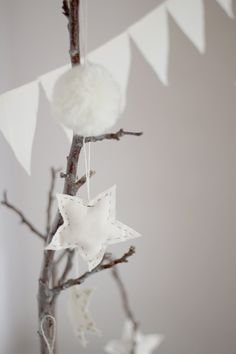 White stars ornaments. €6.00, via Etsy.
