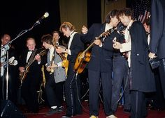 Les Paul, Jeff Beck, George Harrison and Bob Dylan at the Rock and Roll Hall of Fame induction ceremony in New York City, 1988.