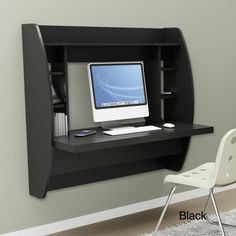 Broadway Black Floating Desk with Storage | Overstock.com.  Looks kind of like an ATM.  Wonder if you could make some sort of 'roll top' concealer.  Some people might not like always seeing the clutter of a computer out for display.
