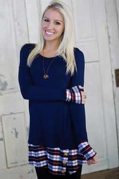 Long sleeve tunic dress with plaid printed hem and cuffs. Button detail on  hem. a21fd4907a