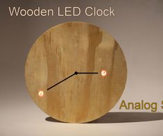 It's an analog style wooden LED clock. I don't know why I haven't seen one of these before..even though the digital types are very common. Anyhoo, here we go!