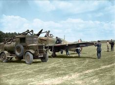 May 1940. Ground crew refuelling a Hawker Hurricane Mk. I of 501 Squadron RAF from an Albion AM 463 petrol bowser at Betheniville, France. Ron Eisele