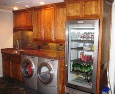 Laundry Room with extra fridge.  Makes more sense than in the garage...especially for the holidays in the winter!