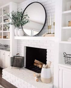 modern farmhouse living room with fireplace decor, fireplace mantle decor, mantle styling in neutral living room design with rustic mantle white brick fireplace with shiplap and open shelf decor, bookshelves next to fireplace Brick Fireplace Makeover, Fireplace Design, Fireplace Ideas, Farmhouse Fireplace, White Mantle Fireplace, Mantle Ideas, Mirror Over Fireplace, White Brick Fireplaces, White Painted Fireplace