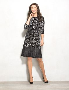 The perfect sweater dress for fall. It comes with a removable sweater jacket (which we'll be mixing and matching with everything from skirts to denim), and its allover print gives your look a bold touch. Complete the look with your favorite heels or boots! Allover black and white geometric print. Imported.