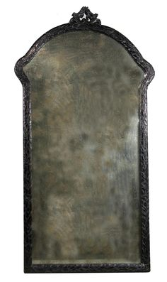 Perfect!  This black rubbed, hand-carved, leaner mirror will broaden and brighten the space.  But the antique mirror keeps things sexy and elegant.  #RANaturals