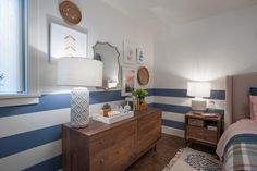 Blue stripes on the lower half of the wall add color without appearing overbearing.