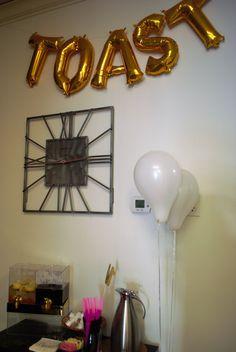 TOAST gold balloons