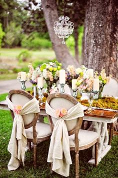 Vintage inspired table setting, chairs with pretty fabric tie backs. Inspiration for a pale pink outdoor Spring wedding.