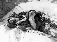Snow-covered body of a soldier of the SS, who was killed during the fighting in the Ardennes.