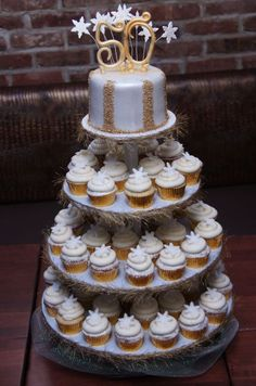 Strike gold with this beautiful cupcake presentation for a 50th birthday.  See more 50th birthday party themes and party ideas at www.one-stop-party-ideas.com