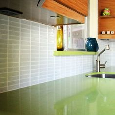 Lush Subway Tile with apple green counter - ideas for what color to paint the cabinets.