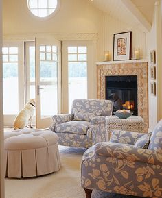 Designer Elizabeth de Jong based the watery palette of the living room (complete with fireplace) on the ottoman's upholstery.