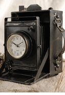 Camera Clock made out of an old 4x5  graflex type camera. Only 19 bucks!