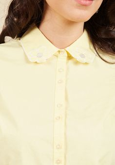 <p>Whether you're toiling away in the workroom or up to something creative in the office, you're provided with fresh inspiration from this yellow button up! An adorable pick from our ModCloth namesake label, this cotton blouse lends its daisy-embroidered collar, cuffed sleeves, and thoughtful darts to your beloved endeavors.</p>