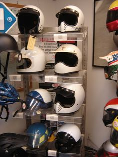 A display shelf in our lobby area with a variety of vintage Bell Helmets.