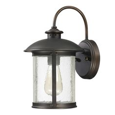 This Dylan collection 1-light outdoor wall lantern features a old bronze finish that will compliment many outdoor decors. The clear antique glass adds interest to this piece.  $116