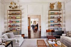Windsor Smith Homefront - Design Chic - love the brass lamps over the bookcases.