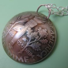 Domed dime pendant. Can't figure out why I like this, but it's just cool.