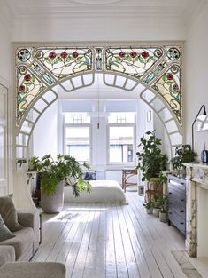 stained glass arch in interior designer anouk Taeymans' Art Nouveau apartmen. - Inspirational Interior Design Ideas for Living Room Design, Bedroom Design, Kitchen Design and the entire home. Decor, House Design, House, Interior Decorating, Interior, I Like Lamp, House Inspiration, Beautiful Homes, House Interior