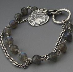 Pretty two strand  bracelet with metal clay charm.