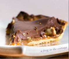 Pierre Hermé's milk chocolate & salted butter caramel crunchy tart. The crunch comes from sprinkling chopped peanuts and nougat between the caramel and chocolate layers.