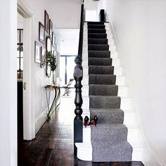 hallway A grey stair runner adds a sophisticated touch to this minimal white hallway. Photograph by Paul MasseyA grey stair runner adds a sophisticated touch to this minimal white hallway. Photograph by Paul Massey Modern Hallway Furniture, Contemporary Hallway, Victorian Hallway, Victorian House, Black Stairs, Black Banister, Banisters, Stair Treads, Flur Design