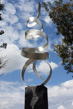 """$325.00; Abstract Modern Metal Garden Sculpture; on Etsy; Dimensions: 48""""H X 10"""" X 10"""". The height includes the 14"""" tall base."""