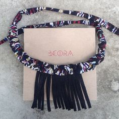 """NEW! Beora Handmade Woven Necklace A beautiful and unique statement piece that will make you stand out. Braided necklace with stitched leather fringe. Each necklace is one of a kind! The braided necklace """"chain"""" can be adjusted to be a choker or to fall lower on your neckline. Beora Jewelry Jewelry Necklaces"""