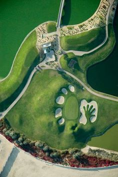 Dubai Golf Club - stunning aerial view, wow what a cool bunker #golf #golfballsunlimited.com