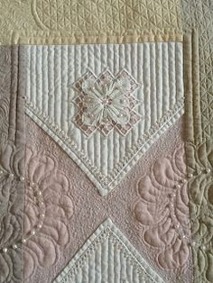 Such lovely soft colours, and gorgeous quilting