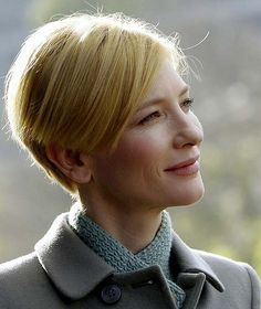 Cate Blanchett. I love this coat and scarf...and she even looks good in this super funky haircut!